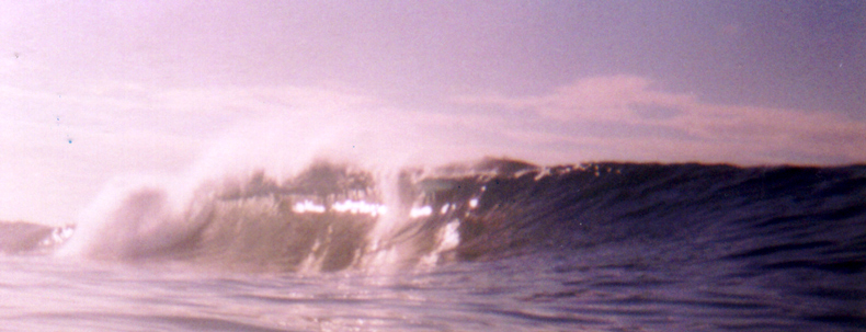 heavy wave over dry reef